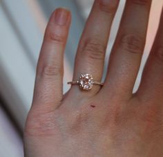 This is a GORGEOUS peach/champagne sapphire in rose gold engagement ring.  [WINK WINK]