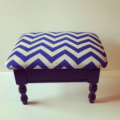 An interesting little footstool with zig zags and a purple like lower half.