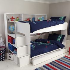 This kids' white bunk bed is a little stunner, with heaps of storage and built-in steps up to the top bunk. Includes stair shelves, integral book holder for top...