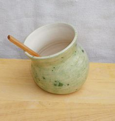 Salt pig or cellar hand thrown pottery with a wooden teaspoon