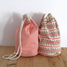 bags. Sew a tube with a pouch thing on top. string through it= drawstring bag. easy alteration