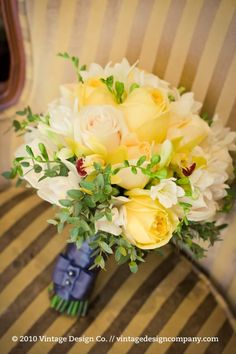 http://www.mimosaflowers.com/includes/images/uploads/KimMoore-YellowBridalBouquet1.jpg