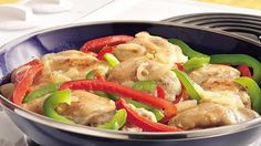 Fresh bell peppers cook up with economical and flavorful chicken thighs in a quick and tasty stovetop dinner for two.