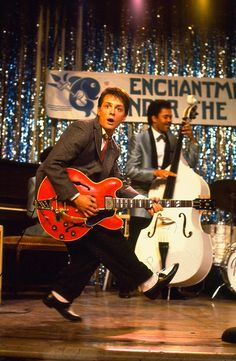 """Michael J. Fox mimicking Chuck Berry's """"Duck Walk"""" during Marty's performance of Berry's """"Johnny B. Goode"""" in Back to the Future (1985)."""