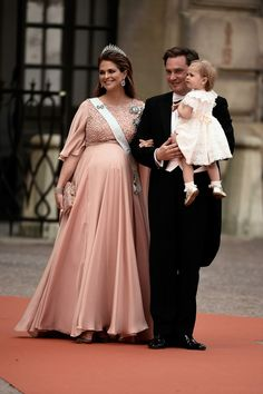Princess Madeleine of Sweden and her husband Christopher O'Neill with their daughter Leonore on his arm arrive for the wedding ceremony; wedding of Prince Carl Philip of Sweden and ms. Sofia Hellqvist on June 13, 2015