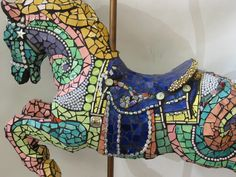 Mosaic Carousel Horse (Life Size) by mosaic artist CeCe Bode...I once did something similar using a child's plastic Wonder Horse, found curbside with an old floor lamp for the pole. #StainedGlassHorse