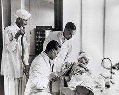 Boy bitten by a viper, receives treatment at the Central Research Institute in Kasauli (Indian Himalayas). The Instiut was engaged in manufacturing antidotes for both military and civilian use. On the left in the picture is the boy's father with a dead snake, which he had brought for identification. The picture was published in the October issue of National Geographic for 1943.