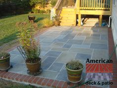 """Abingdon, MD - Flagstone Patio. Full Color 1.5"""" flagstone in Random pattern with soldiers course border. All mortared in atop concrete base."""