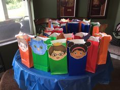 Made my own favor bags. Bags are 13 cents from Walmart. Printed character faces off website and glued them on construction paper, cut out then glue on bags. http://www.pbs.org/parents/birthday-parties/daniel-tiger-birthday-party/