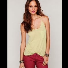 Free People racer tank Raw edges and an asymmetrical cut further the chic, modern style of a semi-sheer slubbed tank finished with a drapey, ring-gathered racerback. Actual tank and color are in photo two, last photo is the same tank but in a different color 113k405  Retail: $58 Size: Small  ❤I have over 300 new with tag Free People items for sale! I love to offer bundle discounts!  ❤No trades. love the item but not the price? Submit an offer! Free People Tops Tank Tops