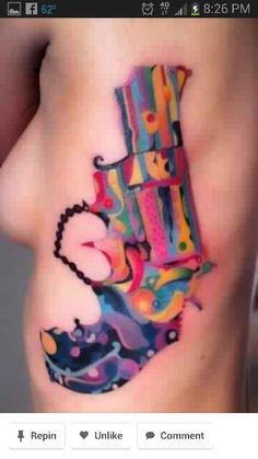 Watercolor gun tattoo