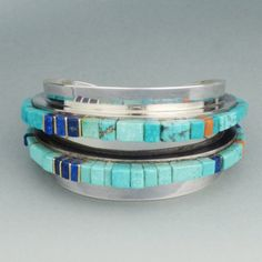 Silver Charles Loloma Bracelet with Turquoise Inlay   Material: silver, turquoise, coral, lapis lazuli and 14k gold