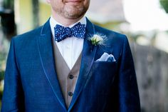 Dapper groom in blue! Photo: Jamie Grenough