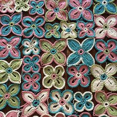 Crochet Spring Flowers by MayaB - Free crochet pattern for the small and medium sized, link for the large ones (Sarah London's Hawaiian Flowers).