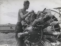 Marine mechanic, Guadalcanal, November 1942 by Marine Corps Archives & Special Collections, via Flickr. Unidentified Marine mechanic services an airplane on Henderson Field, November 1942.    From the Thayer Soule World War II Photograph Collection (COLL/3271) at the Marine Corps Archives & Special Collections.