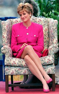 Princess Diana circa 1991.. Diana Princess of Wales in a pink suit, with a pink clutch bag, pink shoes, say on a floral chair. I think this is Canada 1991, looks like her Sudbury, Canada pink suit.