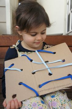 Simple lacing activity for kids using homemade board