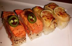 "Wild Sockeye Japanese Aburi ""Hakozushi"" & Toro red Chilli Aburi ""Hakozushi"" - Sockeye Salmon layered with sushi rice box pressed flame torched & topped with Jalapeño. . . . Albacore Tuna marinated in Junmai sake & miso layered with sushi rice box pressed flamed torched & topped with red chilli & key lime slivers #foodie #foodporn #foodspotting #foodgasm #goodeats #delicious #yummy #instafood #japanesefood #sushi #hakozushi #aburi #salmon #sockeye #tuna #toro #chilli #jalepeno #vancouver #yvr…"