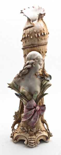 Austrian Ceramic Amphora Vase, Reissner Stellmacher & Kessler, depicting a female bust beside a conch shell, raised on a tree form base. Height 25-3/4 inches.