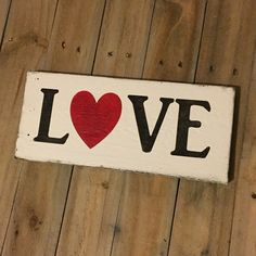 Love sign made from reclaimed wood. Every sign is unique with possible imperfections because they are made from old wood. Each sign is made to order and may not be the exact one pictured. Each sign has been hand painted with care using specialty paints and acrylics. Each sign is distressed and rustic