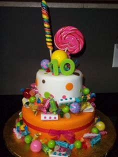 i made this cake for my daughters 10th birthday, her party was a candy theme.Fondant covered white and bubble gum flavored 10 and 6 cakes.There is a 6 inch piece of styrofoam in between the tiers that all the candy is attached to.