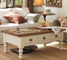 I typically don't like this style, but it would be an interesting contrast to have a white coffee table.