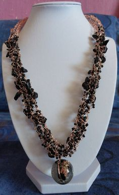 Black Peach Necklace. Intertwined wire with glass beads. Available at the Pukeko Alley Art Gallery in Fortrose, Catlins.