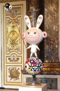 "The sculpture ""Kaikai & Kiki"" by Japanese artist Takashi Murakami is displayed at the Chateau de Versailles, outside Paris"