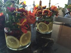 This is a cute and simple idea to use bath and body work 3 wick glass candle jars. Put the jar in the freezer for an hour and the remaining candle comes right off than wash. Thinly slice lemons and add fresh cranberries, water and arrange flowers. You can use these has centrepieces for just about anything! Have fun using your creativity:)) I used these for my thanksgiving dinner tables! Reuse Candle Jars, Candle Containers, Glass Candle, Bath Candles, 3 Wick Candles, Diy Candles, Centrepiece Ideas, Jar Centerpieces, Fresh Cranberries