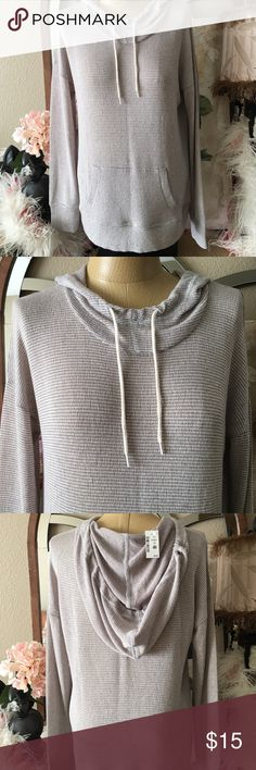 """Aeropostale Live Love Dream Sweater Size XL New Brand new with tags Aeropostale thin pullover hooded sweater. It is gray and white with kangaroo pocket in front. Material is 56 percent polyester, 41 percent rayon, 3 percent spandex. The sweater is very soft and thin and has a lot of stretch to it. It measures 23"""" from arm pit to arm pit and 28 from shoulder to bottom of hem. The sleeves are nice and long. Comes from pet free, smoke free home. Aeropostale Sweaters Crew & Scoop Necks"""