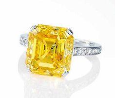 A SUPERB COLOURED DIAMOND AND DIAMOND RING 2