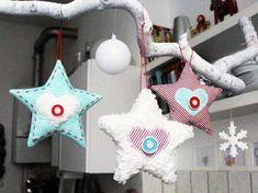 Tutoriales DIY: Cómo hacer estrellas de Navidad con tela vía DaWanda.com