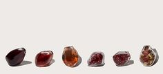 """Finding so many glass pomegranate seeds...  These are by Vani Alana Winick.    """"Glass pomegranate seed-shaped vessels, protecting true seeds from any forms of genetic modification. """"  The craftsmanship is somewhat lower than what Jason Stropko can make with his expertise or indeed what Catherine Vamvakas has made long before Noa P. Kaplan got inspired to have some made.   Yet we like the idea a lot. #design"""
