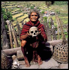 "IFUGAO HEAD HUNTING TROPHY SKULL HELD BY AN IFUGAO ""MOMBAKI"" SHAMAN IN THE VILLAGE ""BATAD"" PHILIPPINES FEATURED IN THE BOOK: ""THE LAST FILIPINO HEAD HUNTERS"" ON PAGE #142"