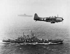 US Navy Douglas SBD Dauntless flies patrol over the USS Washington and USS Lexington during the Gilbert and Marshall Islands campaign 1943