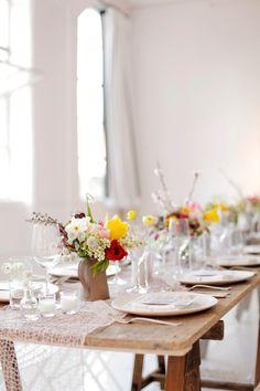 beautiful tablescape - dinner table set with flowers by stylist Jenn Elliott Blake