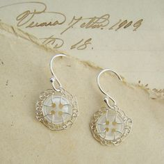 Vintage mother of pearl button earrings by Judith Brown Jewellery. #Vintage mother of pearl #buttons are around 100 years old and handstitched with #silver wire.