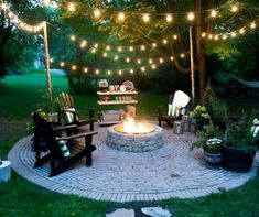 Beautiful backyard scene, with rope lights strung between movable poles stabilized in concrete.