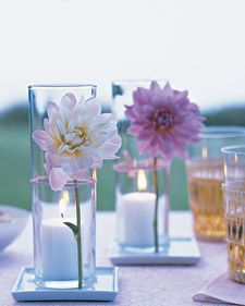 Flower Votive Displays - Flowers and candlelight are nothing new, but together they create tabletop decorations fit for relaxed summer entertaining. Place votive candles in tall glass vessels, and att (Corona Bottle Centerpieces) Votive Centerpieces, Simple Centerpieces, Baby Shower Centerpieces, Wedding Centerpieces, Wedding Decorations, Table Decorations, Votive Candles, Candels, Wedding Ideas