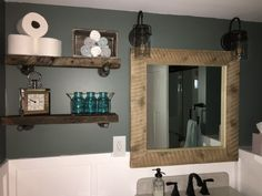 Barn wood! Brady bought barn wood at Rustic Revival Barnwood to frame a mirror and make floating shelves for his bathroom. Love!  Come in and shop for your DIY project!  Http://www.facebook.com/rusticrevivalbarnwood  #reclaimed #rustic #barn #wood #rusticrevivalbarnwood #minnesota #mirror #shelves
