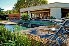 The 4 star Lily Pond Country Lodge is situated in Plettenberg Bay, along South Africa's popular coast, the Garden Route. Clifton Beach, Cape Town Hotels, Lily Pond, Holiday Destinations, Lodges, Hotel Offers, South Africa, Swimming Pools, Mansions