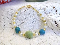 Handmade Bracelet with Glass Pearls, Gold Beads, Seed Beads, Turquoise Nuggets & Lime Green Nugget. $9.00, via Etsy.