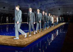 Rem Koolhaas floats Prada SS15 catwalk on blue pool.