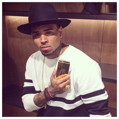 Chris Brown receives personally engraved 24ct. Gold iPhone 6 in L.A.