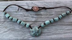 My talented friend makes these! Handmade Green Ceramic Lotus Necklace with by JoyfulGemsandStones, $42.00