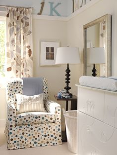 Sarah Richardson:  When designing kids' rooms, Sarah always tries to stay away from the conventional. Rather than juvenile prints and pastel colors, Sarah opted for a sophisticated, leaf-print linen for the drapes and a coordinating color palette of muted grays, pale blues and soft browns. A piece of flat trim installed all the way around the room plays up the two-color paint scheme.
