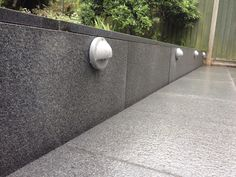 Blue/Grey granite paving & cladding detail with complimentary grey downlights.