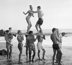 Actors in a Hollywood movie amuse themselves between shooting of scenes at California's Malibu Beach, 1965