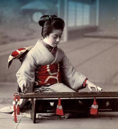 GEISHA PLAYING A YAKUMOGOTO -- A Two-Stringed Zither of the Oomoto Shinto Sect (#1 of 2), via Flickr.