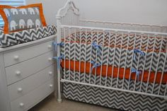 Grey Chevron, orange and light blue crib bedding.  Elephant lumbar pillow.